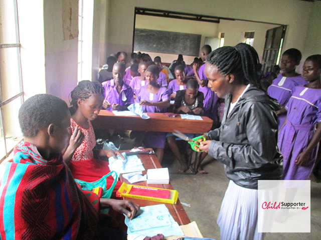 CSHP_Children leaning how to make re-usable pads.jpg