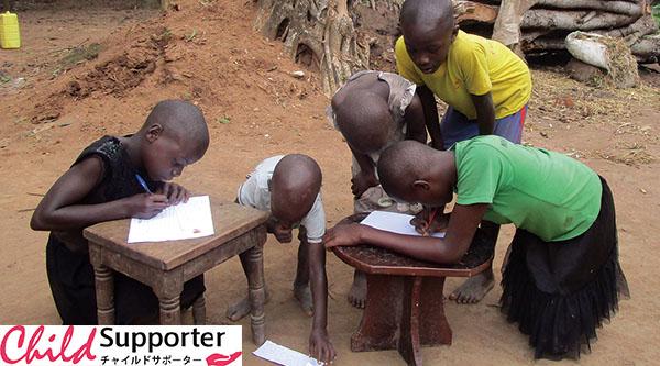 Children involved in writing correspondences (1) のコピー.jpg